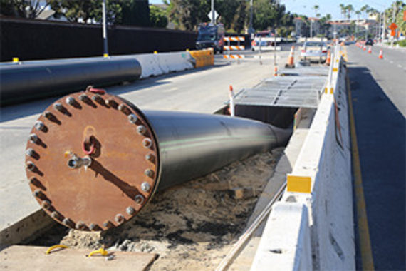 HDPE piping being installed underneath a historic highway